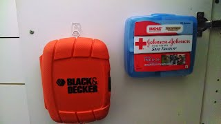 The first aid kit was cheap and easy to hang, but I had to stuff an eye hook into the screwdriver case because of the recessed back that was too thick for the velcro